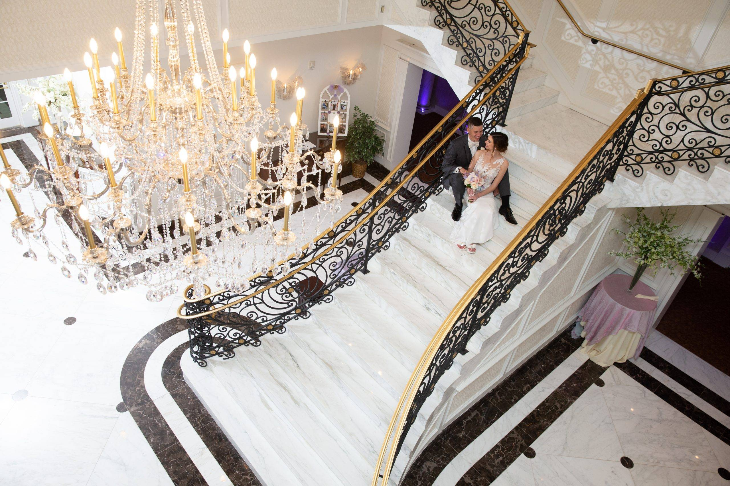 Meadow Wood wedding couple sitting on staircase from above