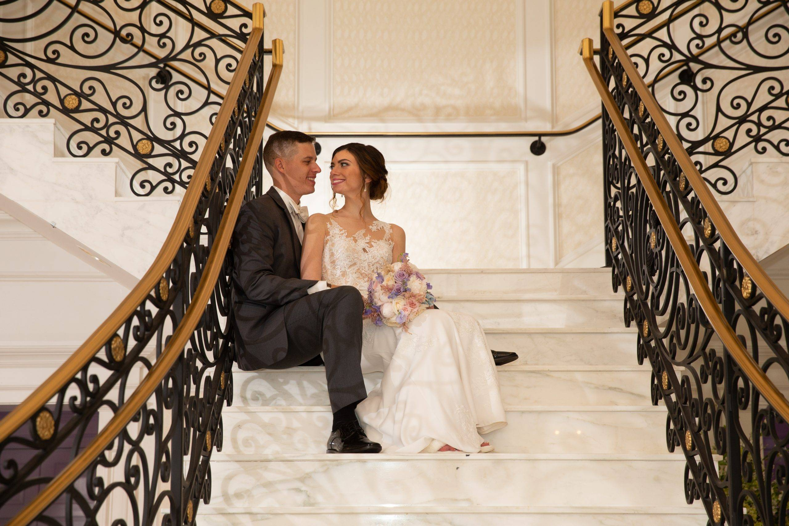Meadow Wood wedding couple sitting on staircase