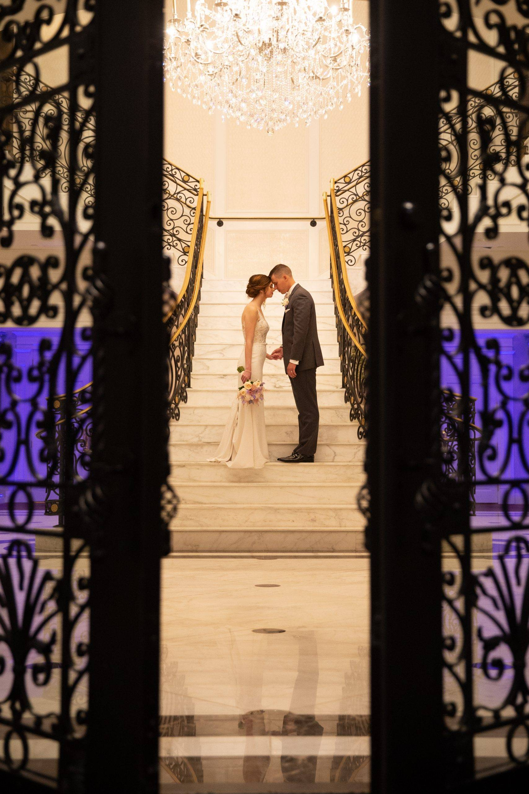 Meadow Wood wedding couple sneaking a kiss on the staircase