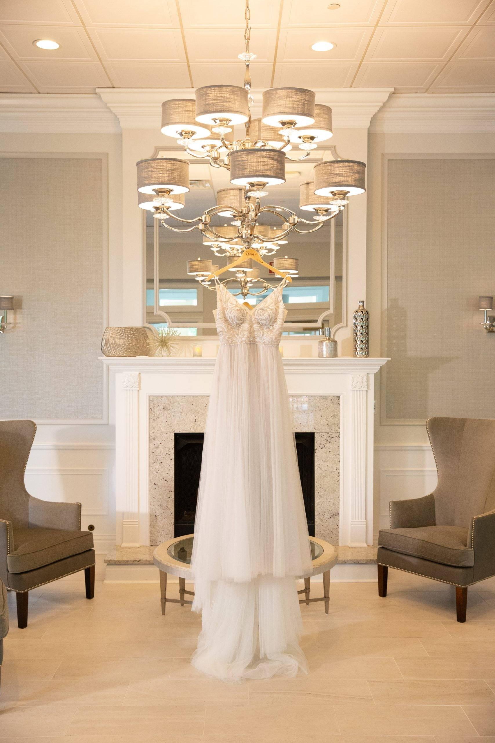 Brooklake wedding dress hanging by fireplace