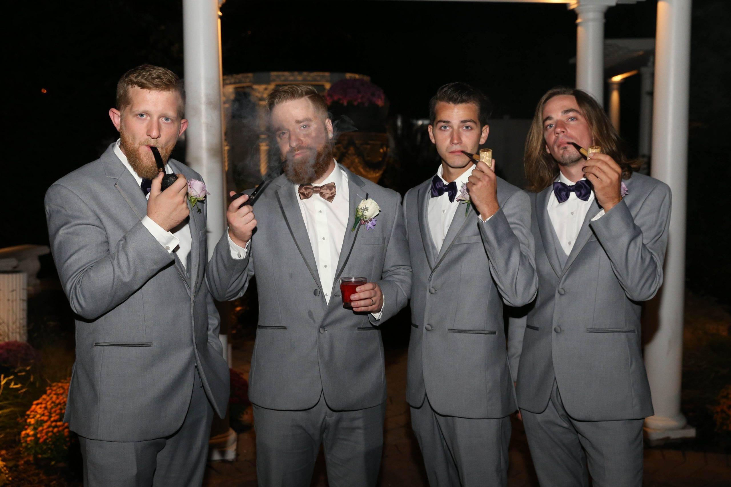 Primavera Regency groom and groomsmen smoking pipes
