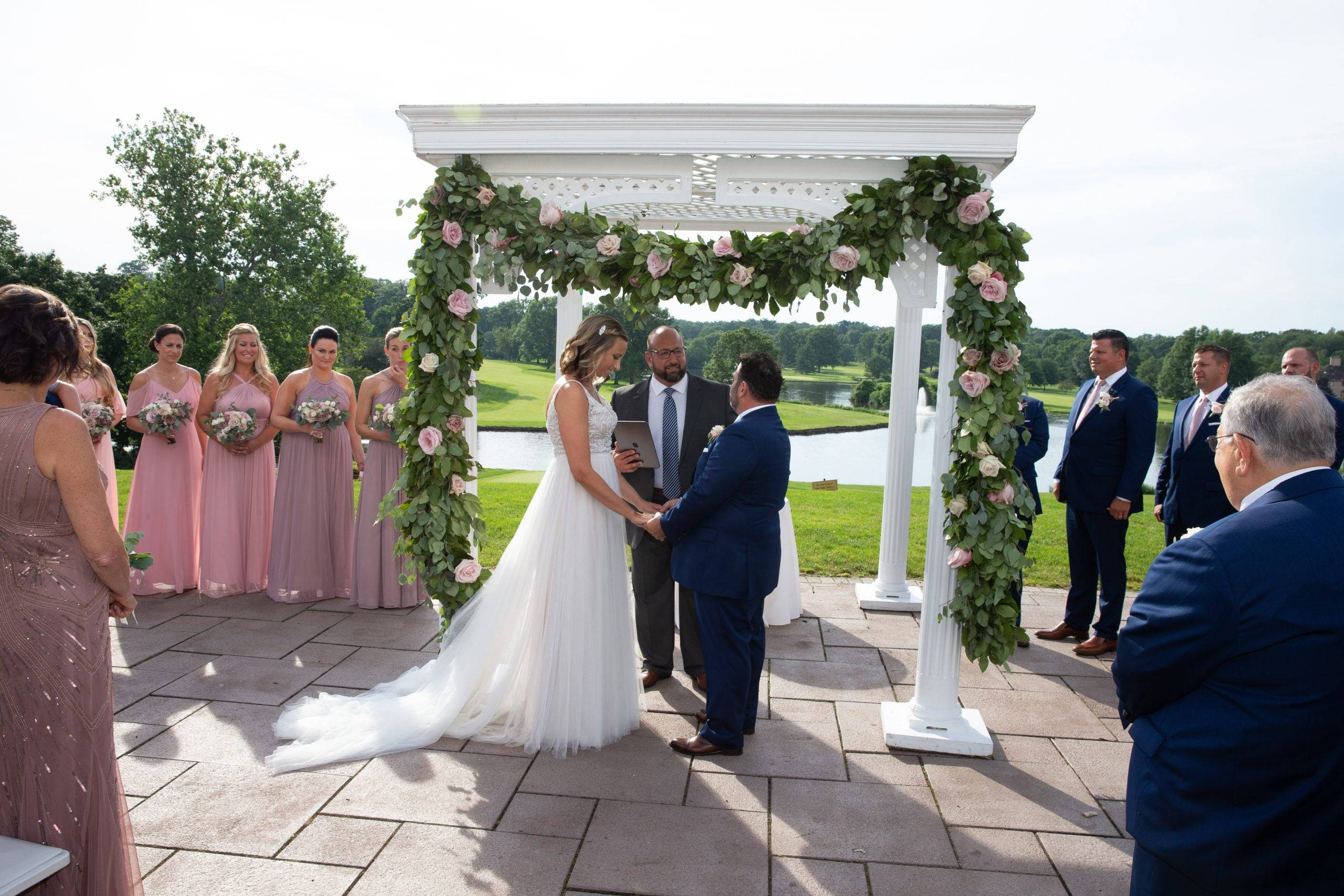 Brooklake bride and groom exchanging vows outside