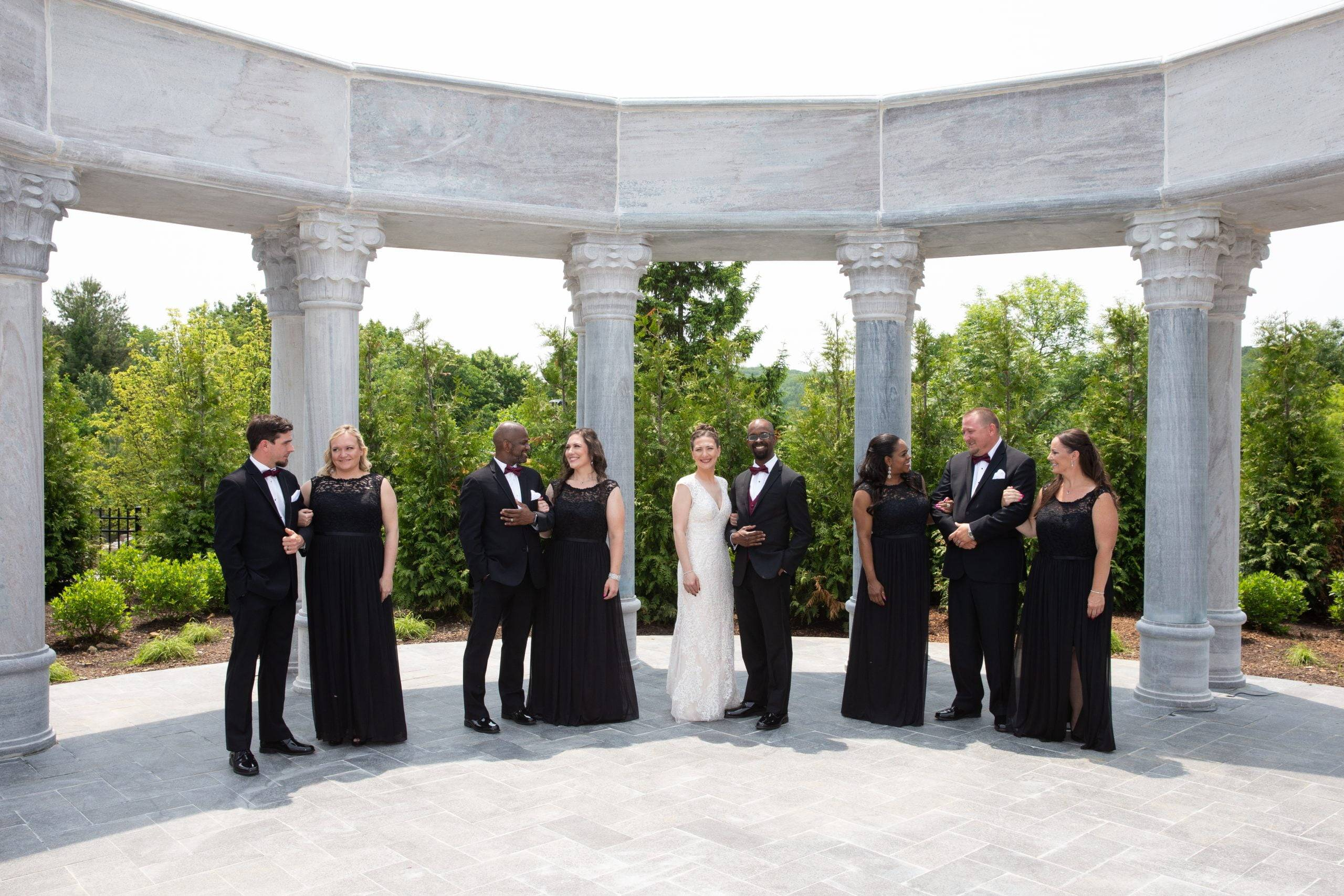 Meadow Wood wedding party outside by columns