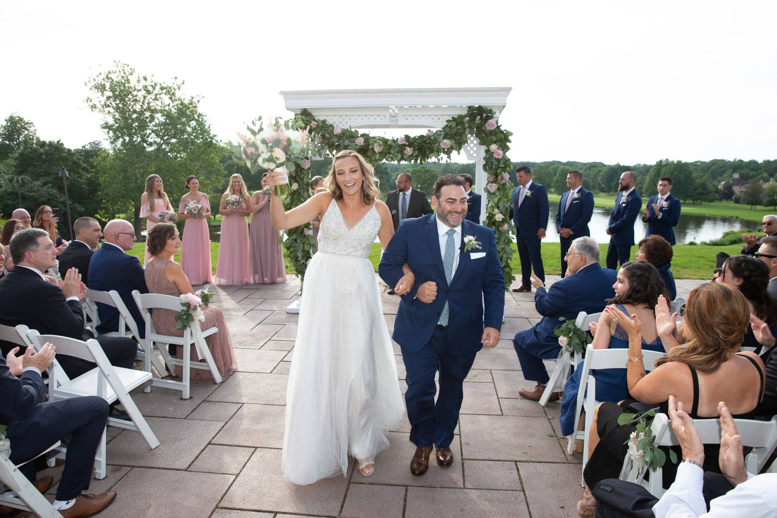 Brooklake bride and groom walking down the aisle outdoor ceremony