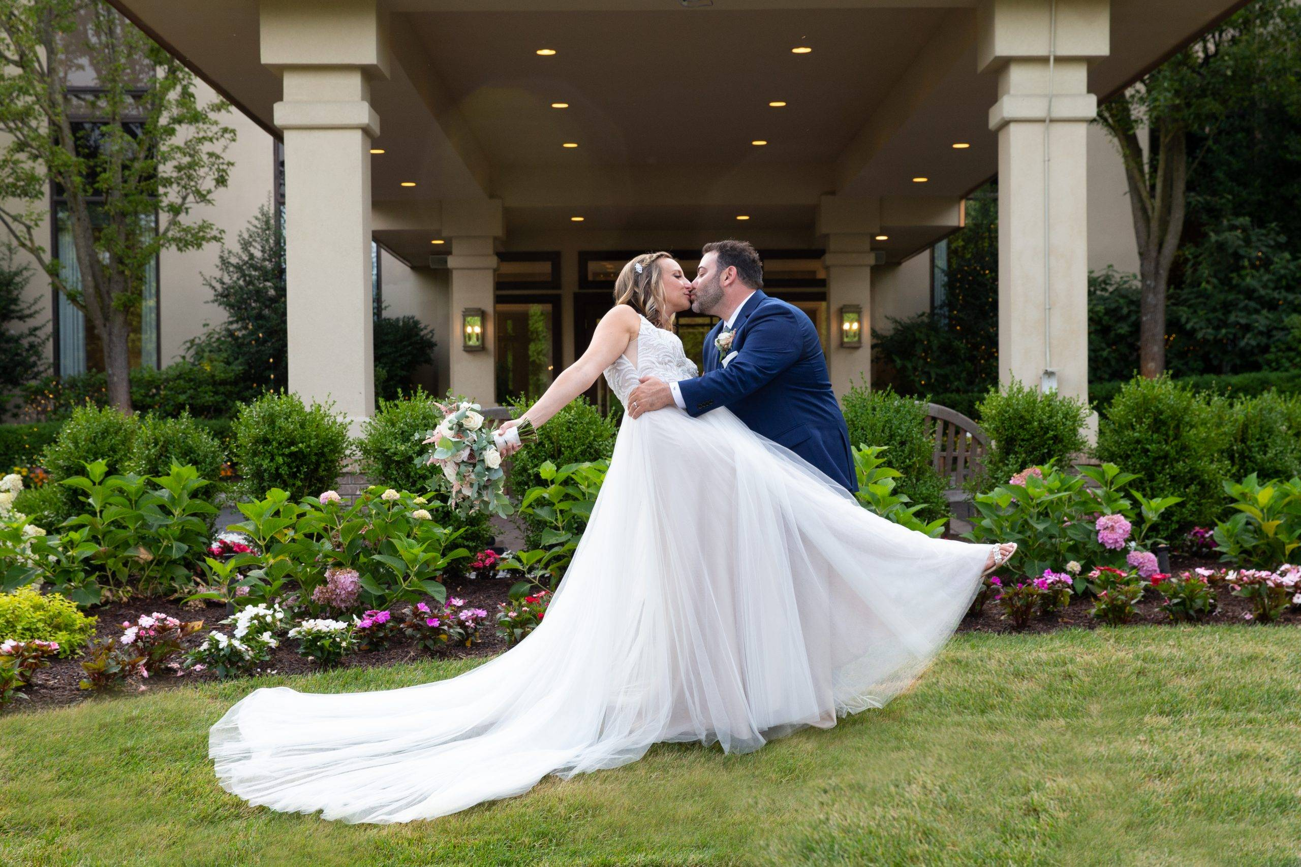 Brooklake bride and groom kissing by country club