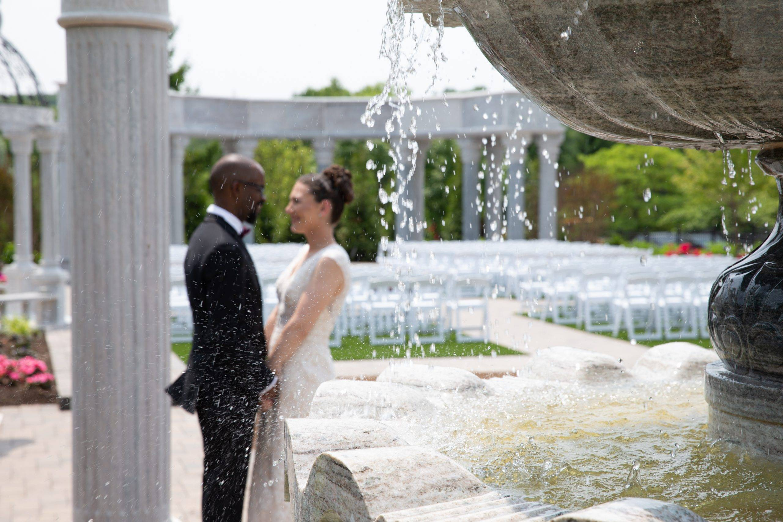 Meadow Wood wedding couple outside by columns