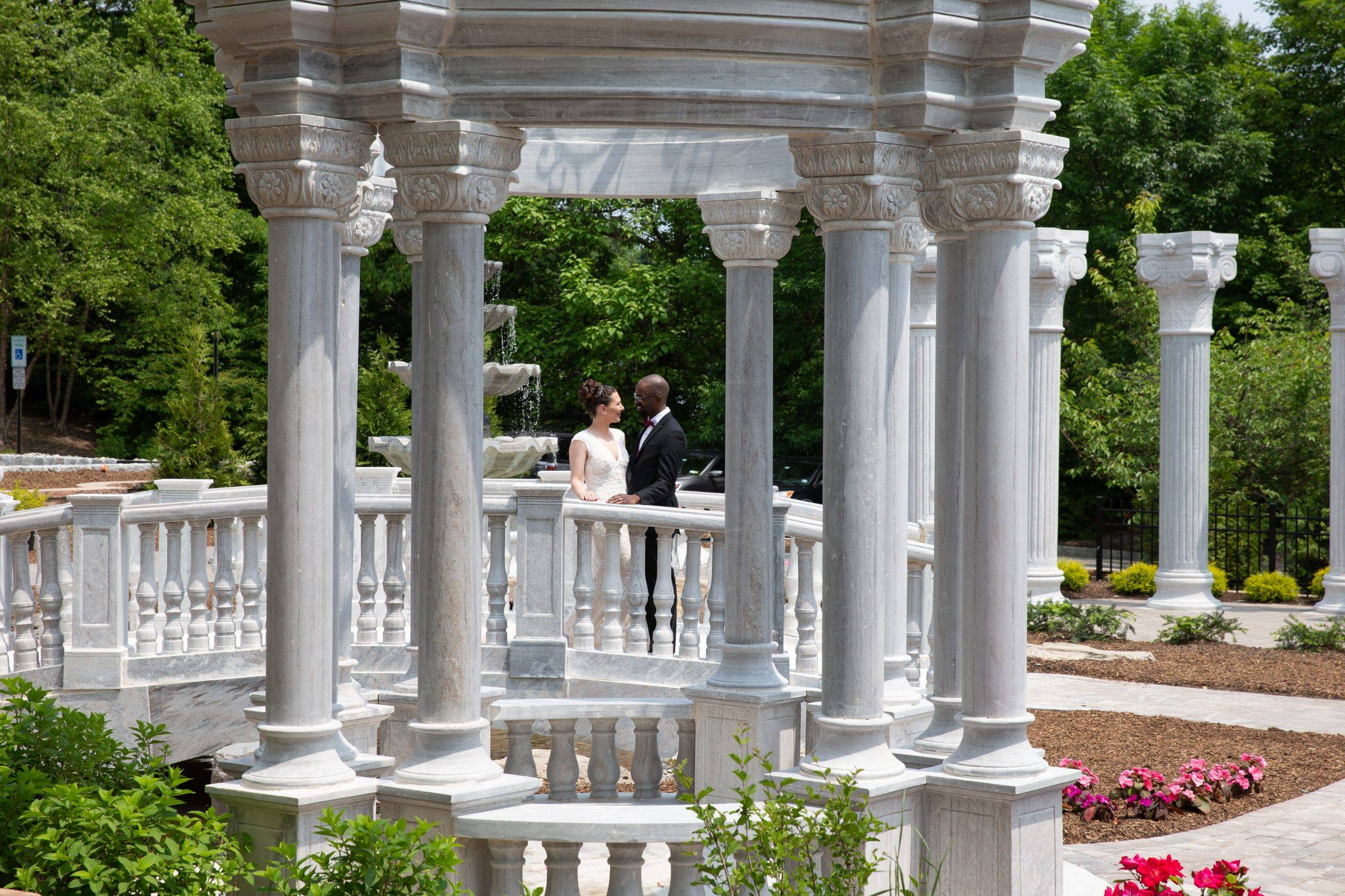 Meadow Wood wedding couple outside by columns and gazebo