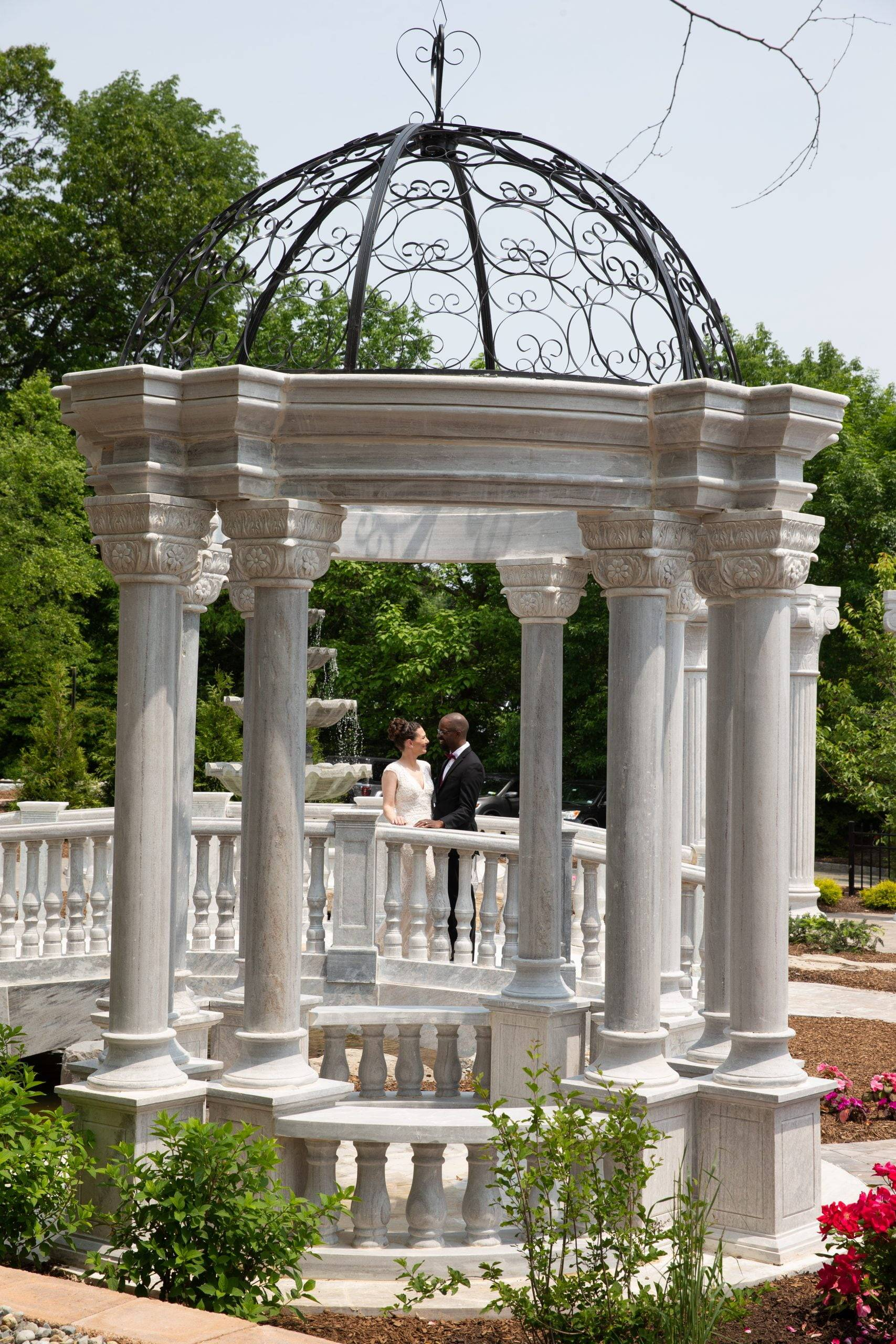 Meadow Wood wedding couple on patio by columns