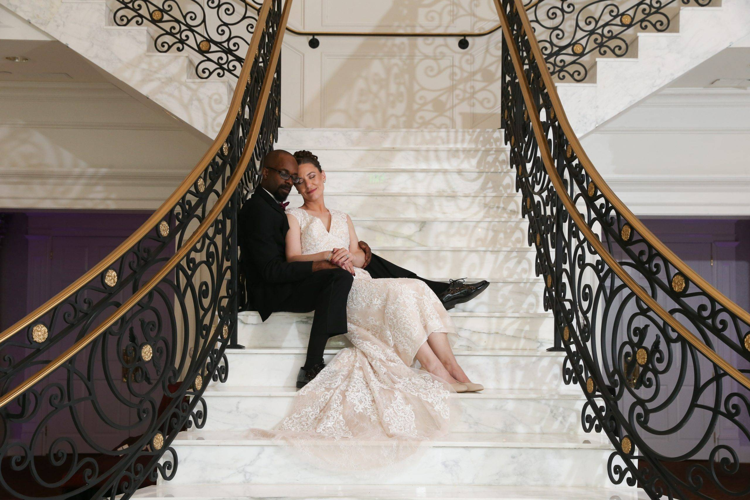 Meadow Wood bride and groom relaxing on grand staircase