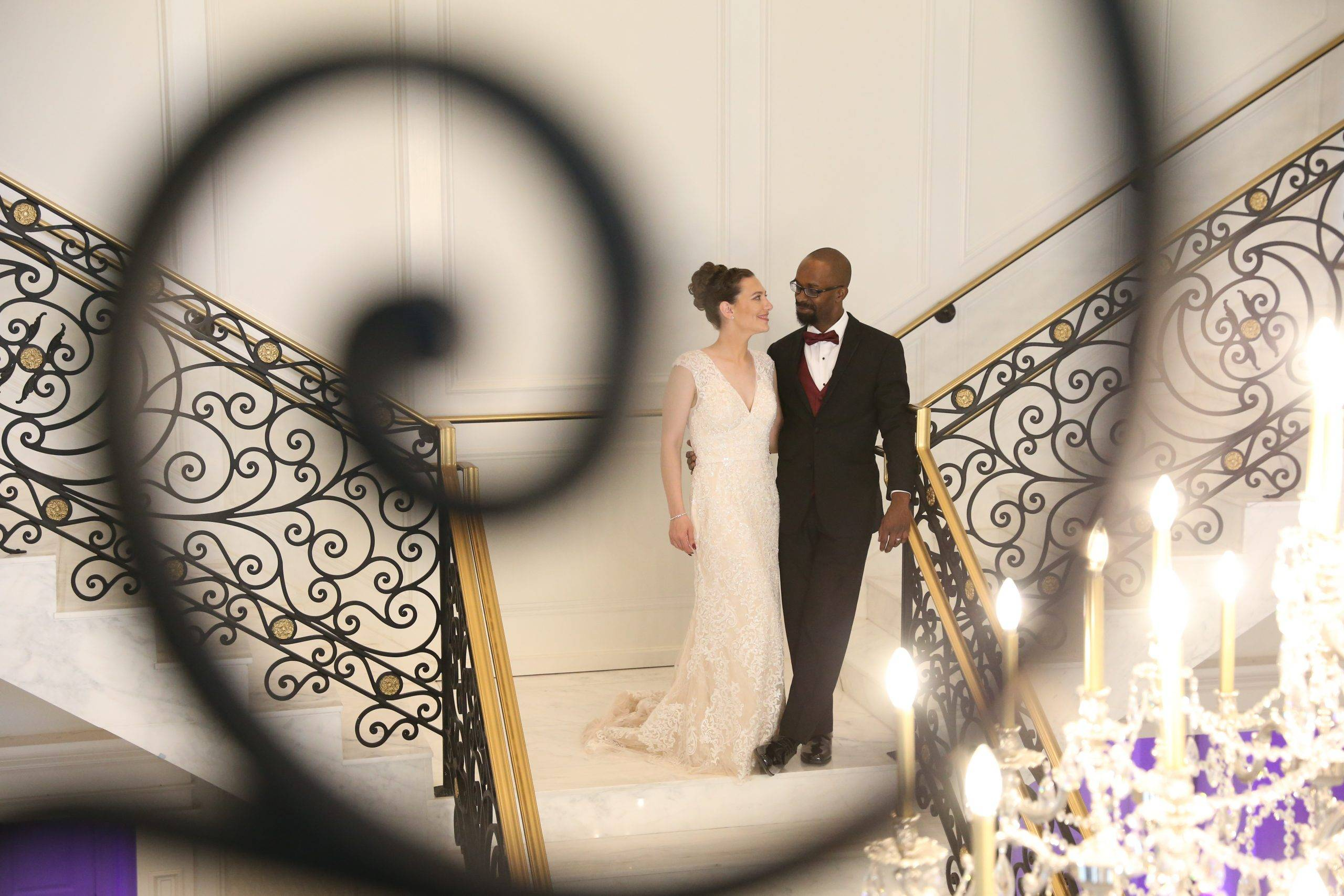 Meadow Wood bride and groom walking down grand staircase