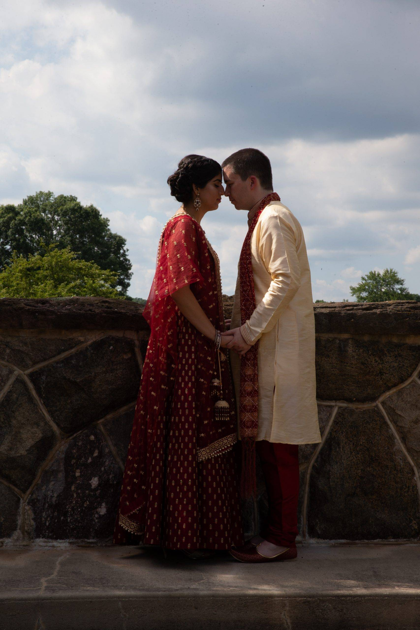 Brooklake Indian bride and groom kiss on patio