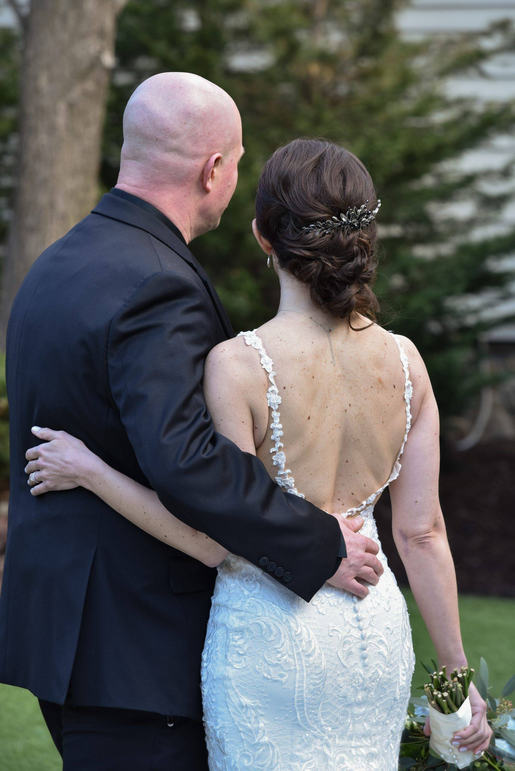 Olde Mill Inn wedding couple from behind