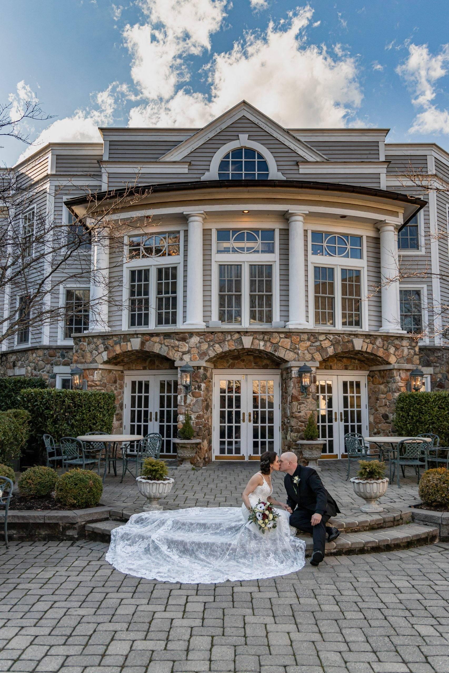 Olde Mill Inn bride and groom kiss on outside steps