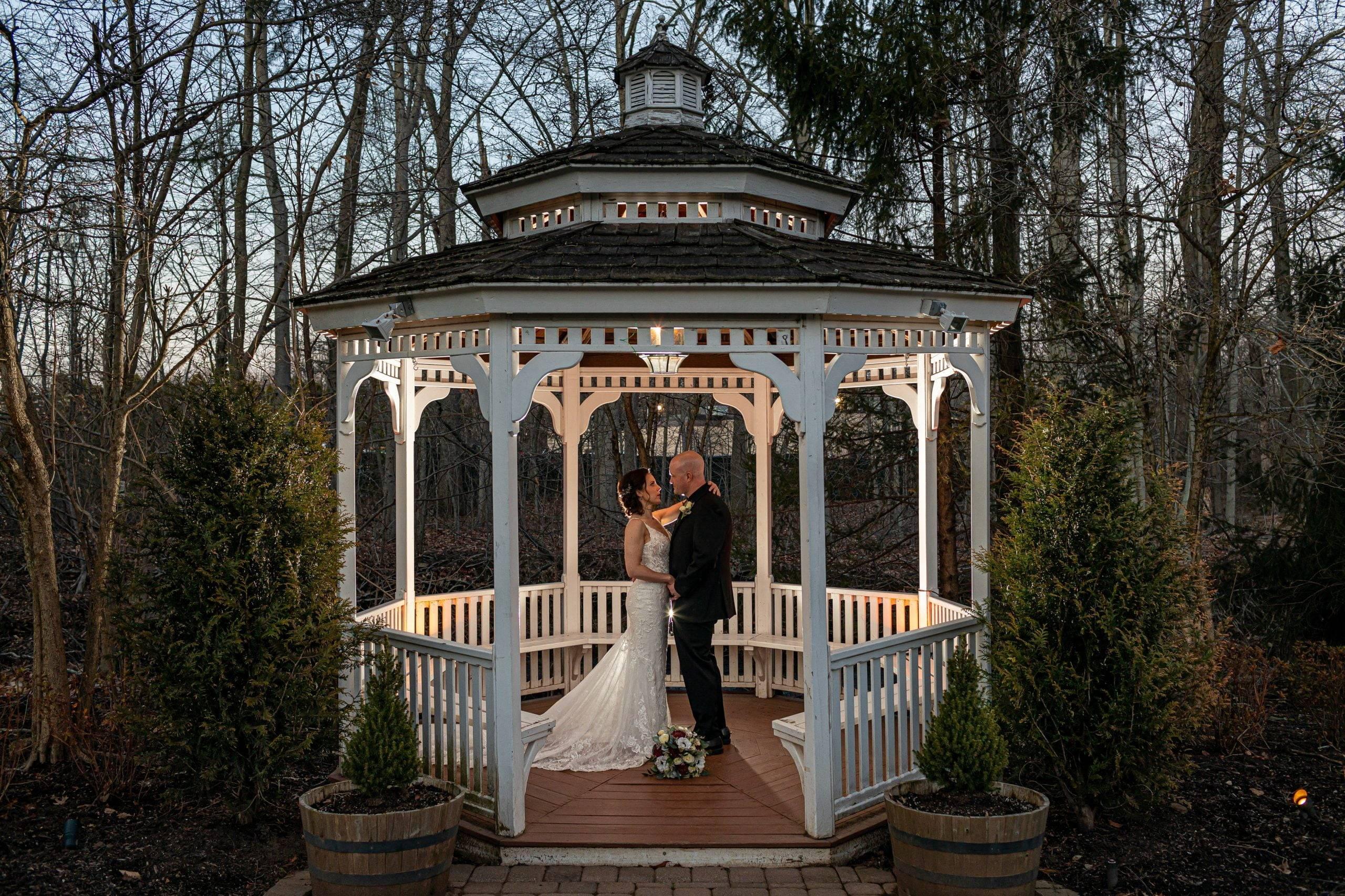 Olde Mill Inn bride and groom in the gazebo