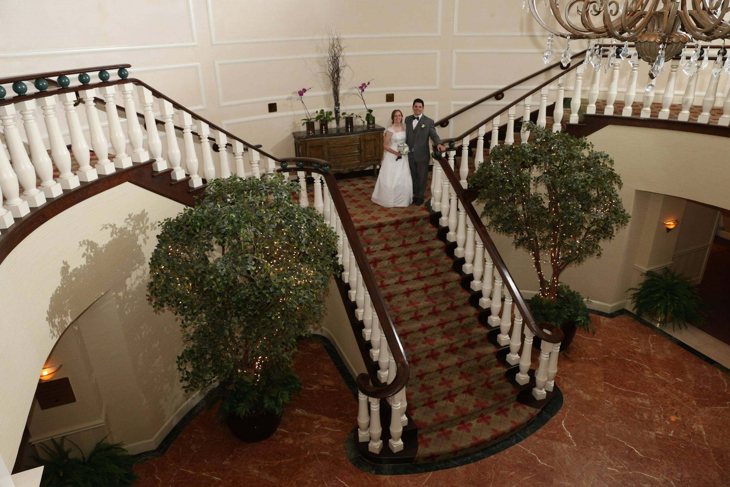 Bridgewater Manor wedding couple on staircase from above