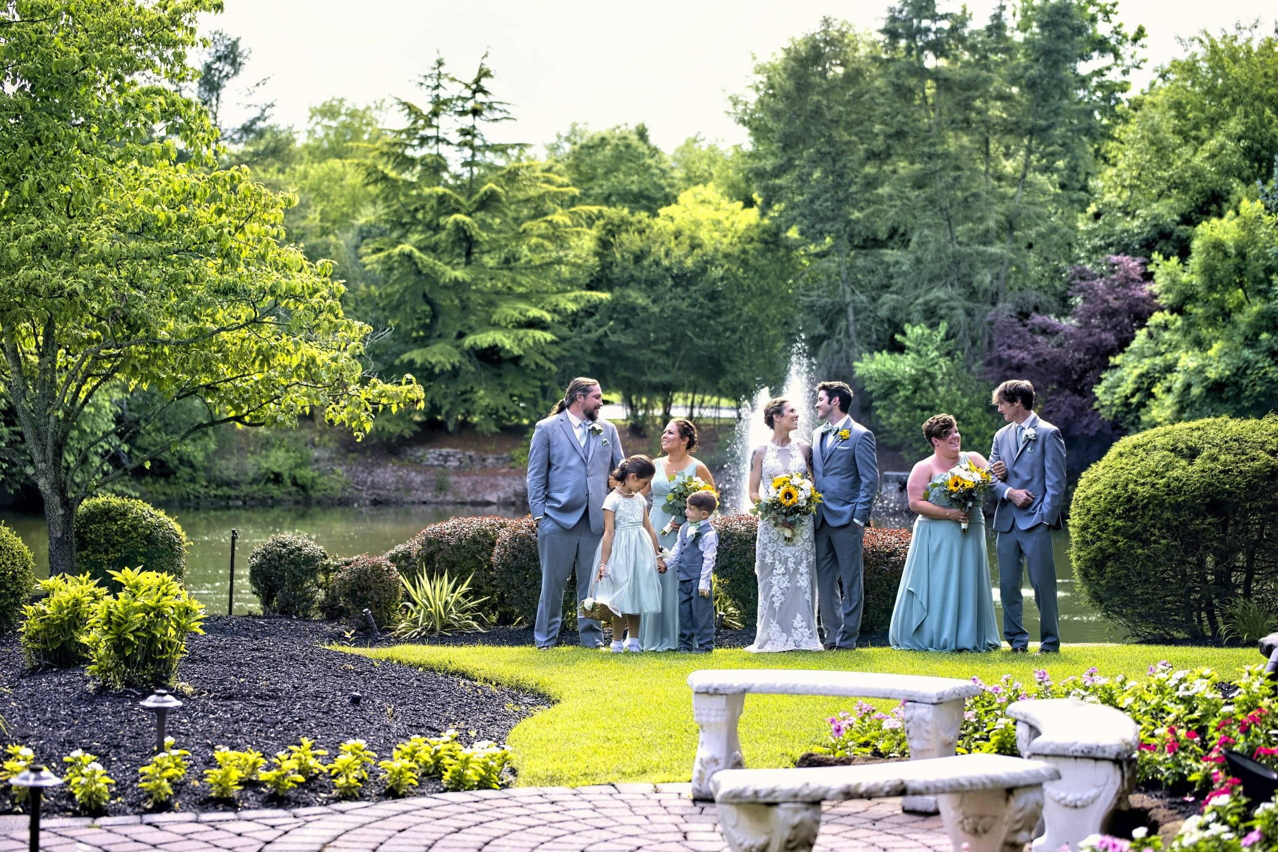 Bridgewater Manor wedding party in gardens by fountain