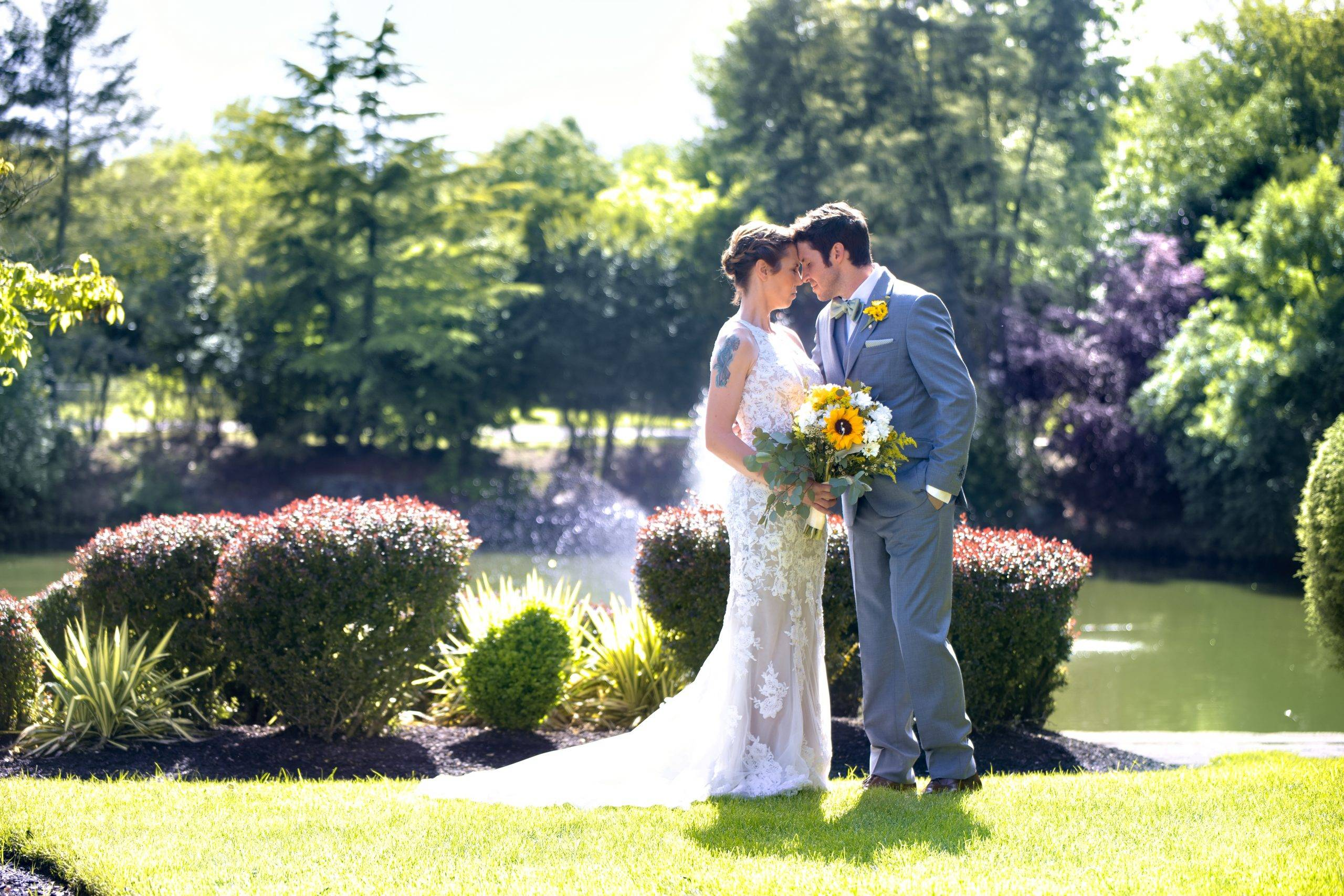 Bridgewater Manor bride and groom in gardens by fountain