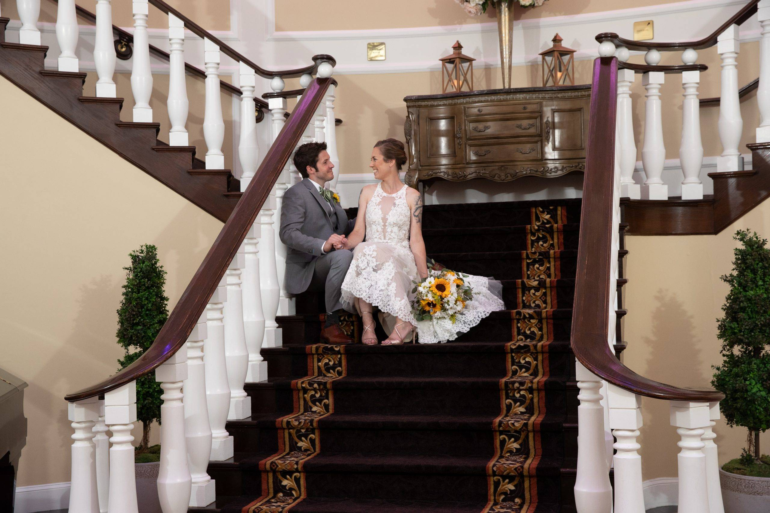 Bridgewater Manor bride and groom relax on staircase