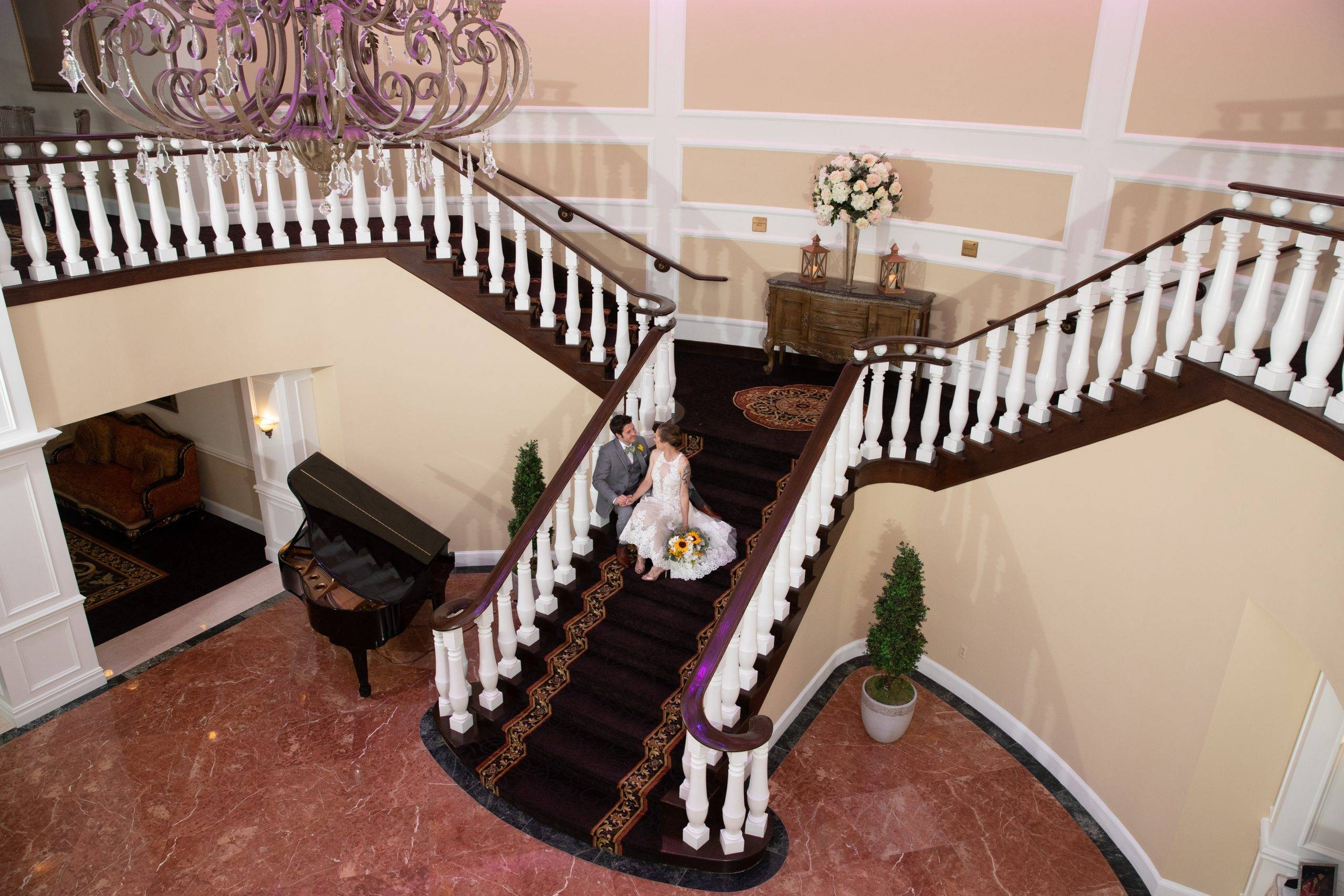 Bridgewater Manor wedding couple relaxing on staircase from above