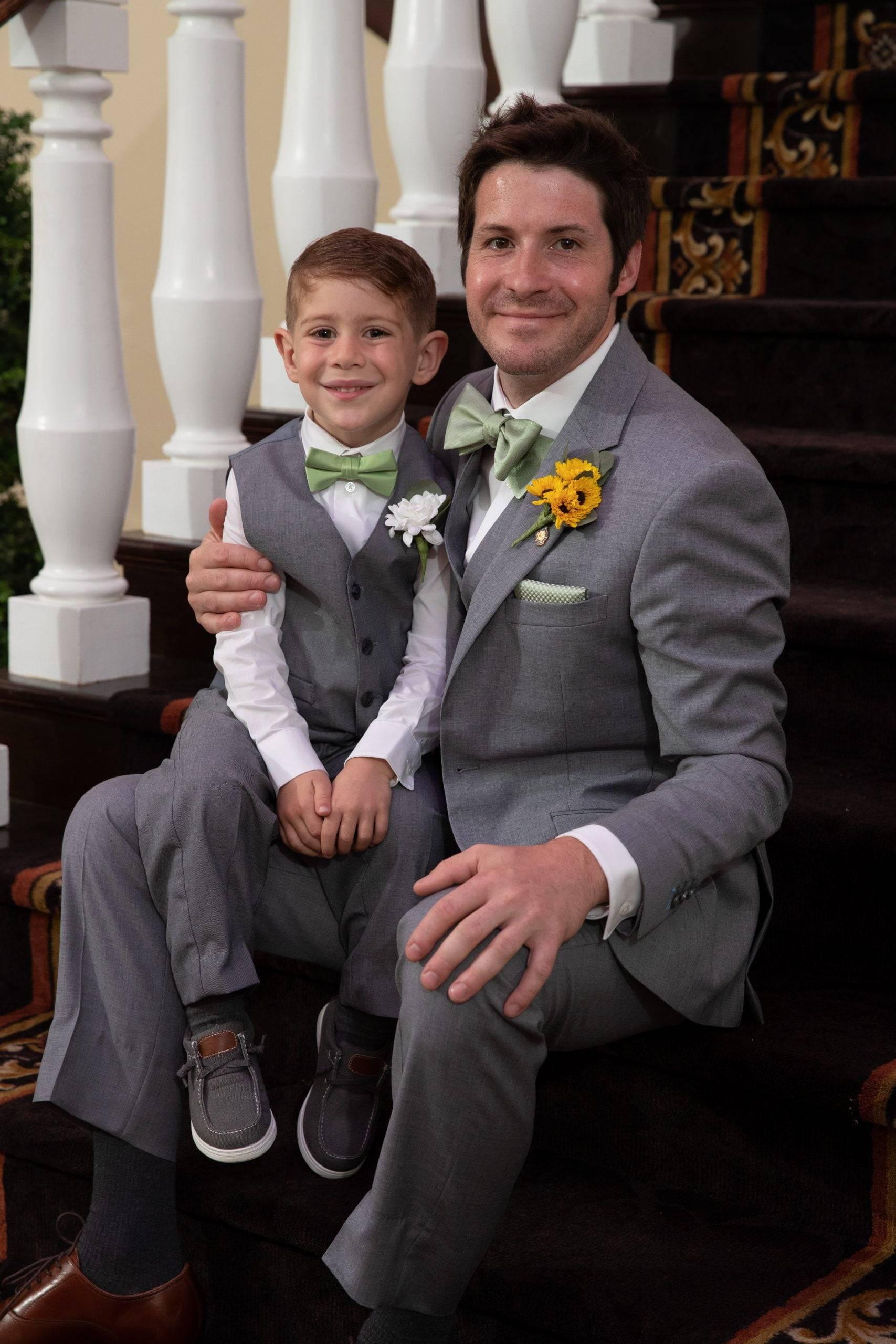 Bridgewater Manor ring bearer with groom on staircase