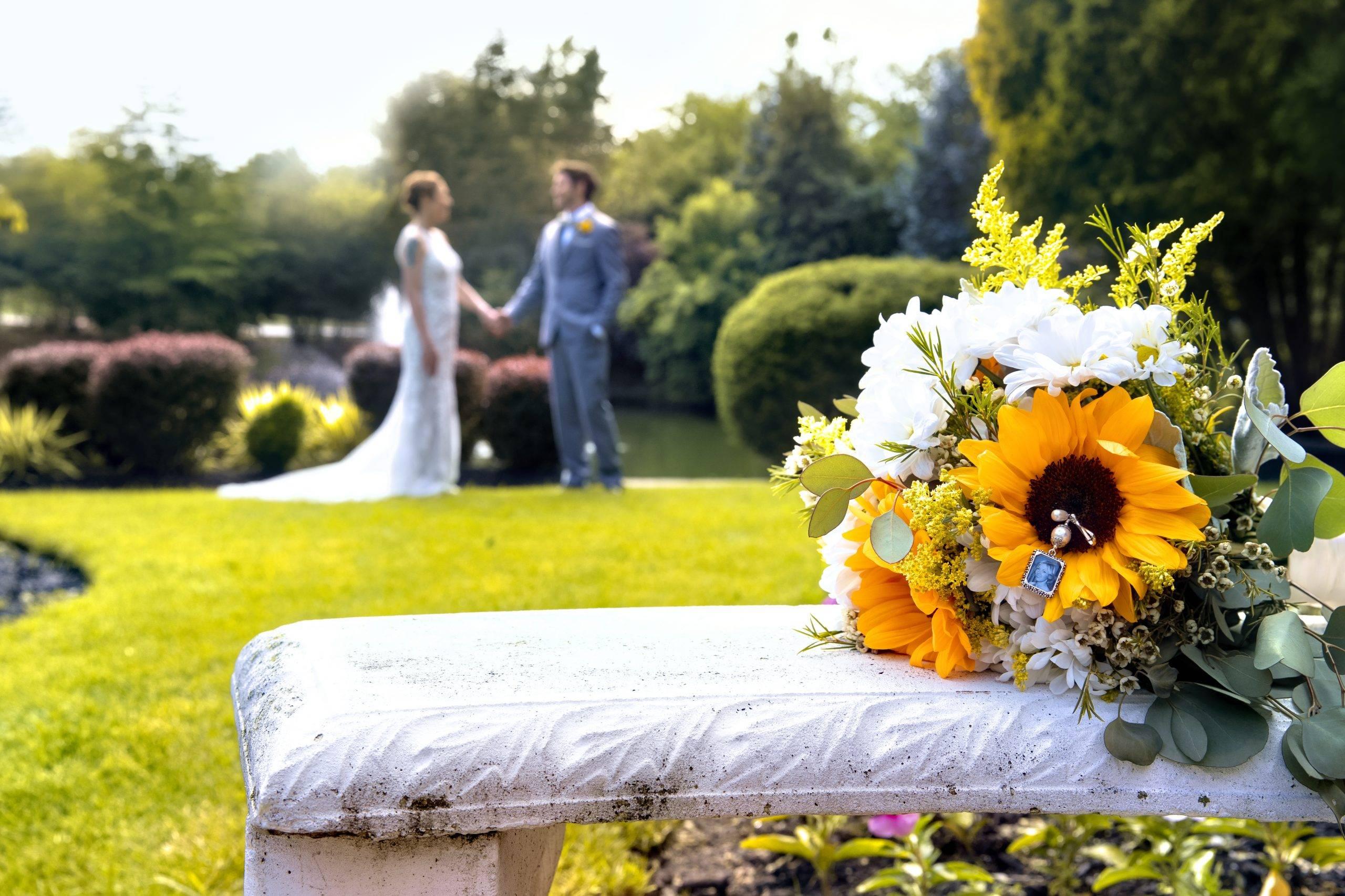 Bridgewater Manor bride and groom holding hands in gardens