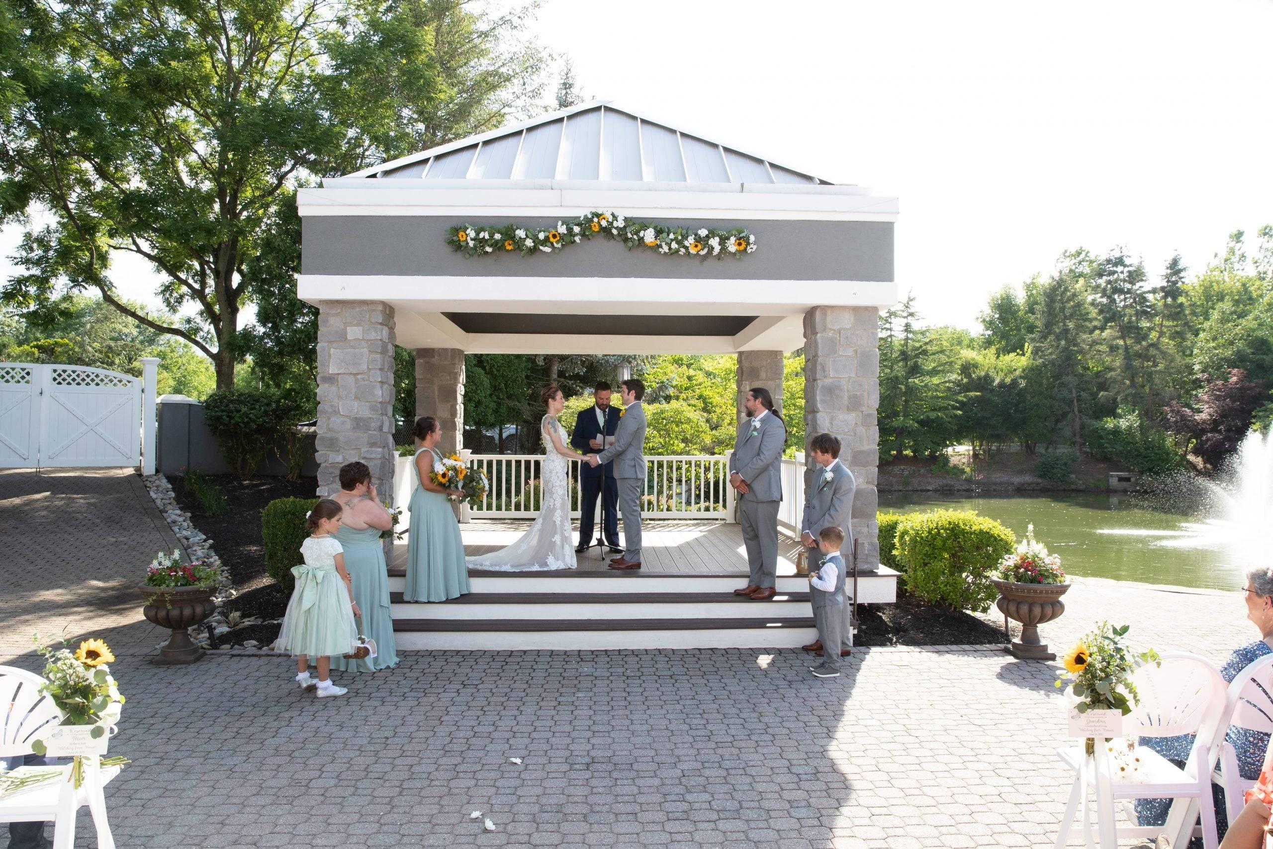 Bridgewater Manor wedding ceremony in outdoor altar