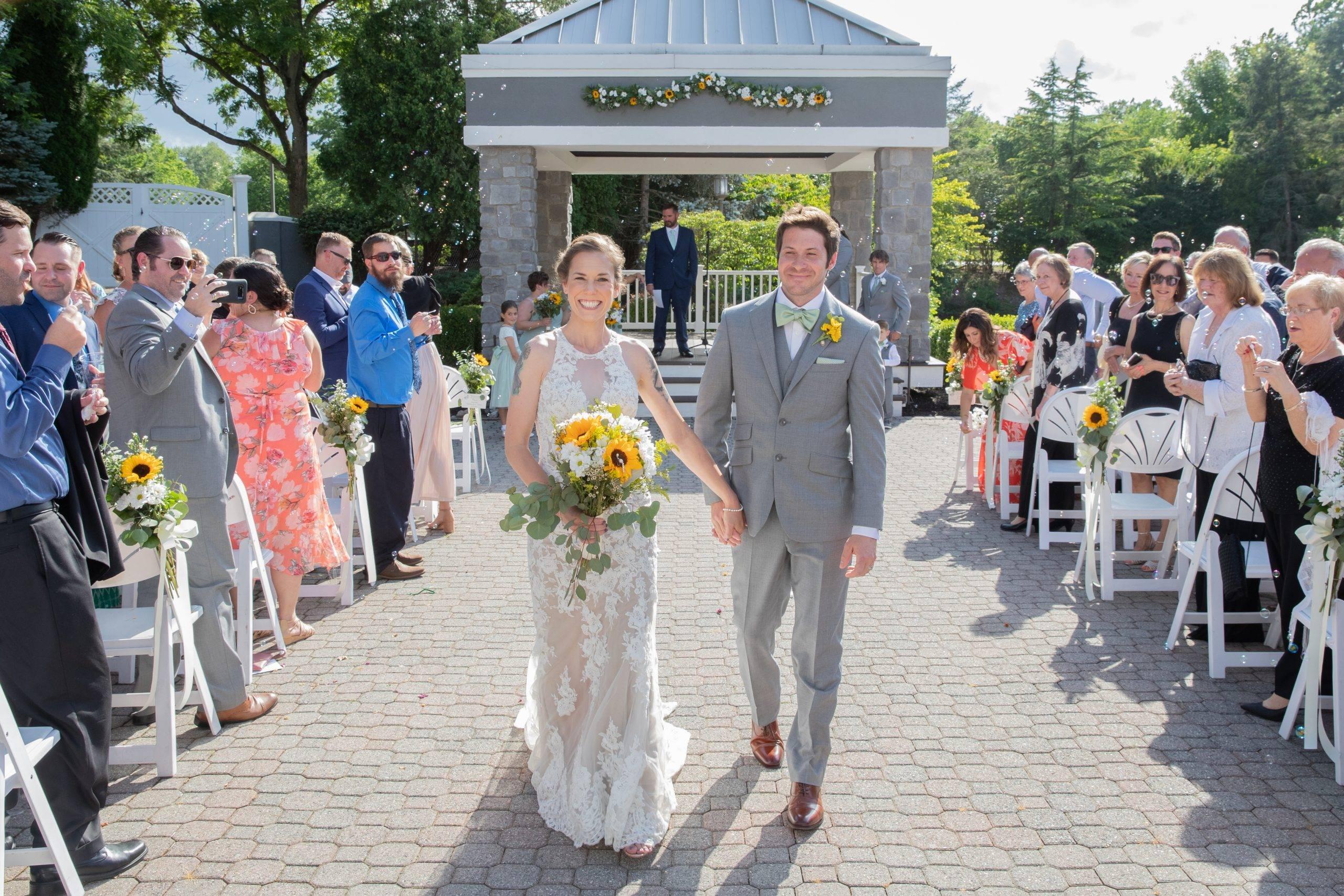 Bridgewater Manor bride and groom in outdoor wedding ceremony